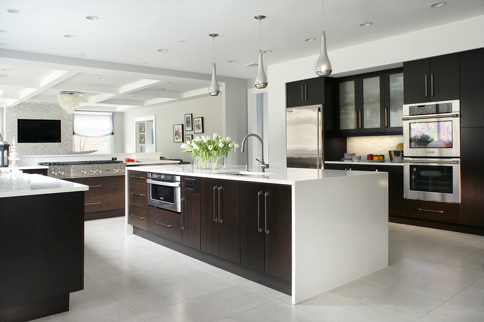Inspiration for a contemporary white floor kitchen remodel in New York with flat-panel cabinets, stainless steel appliances and dark wood cabinets