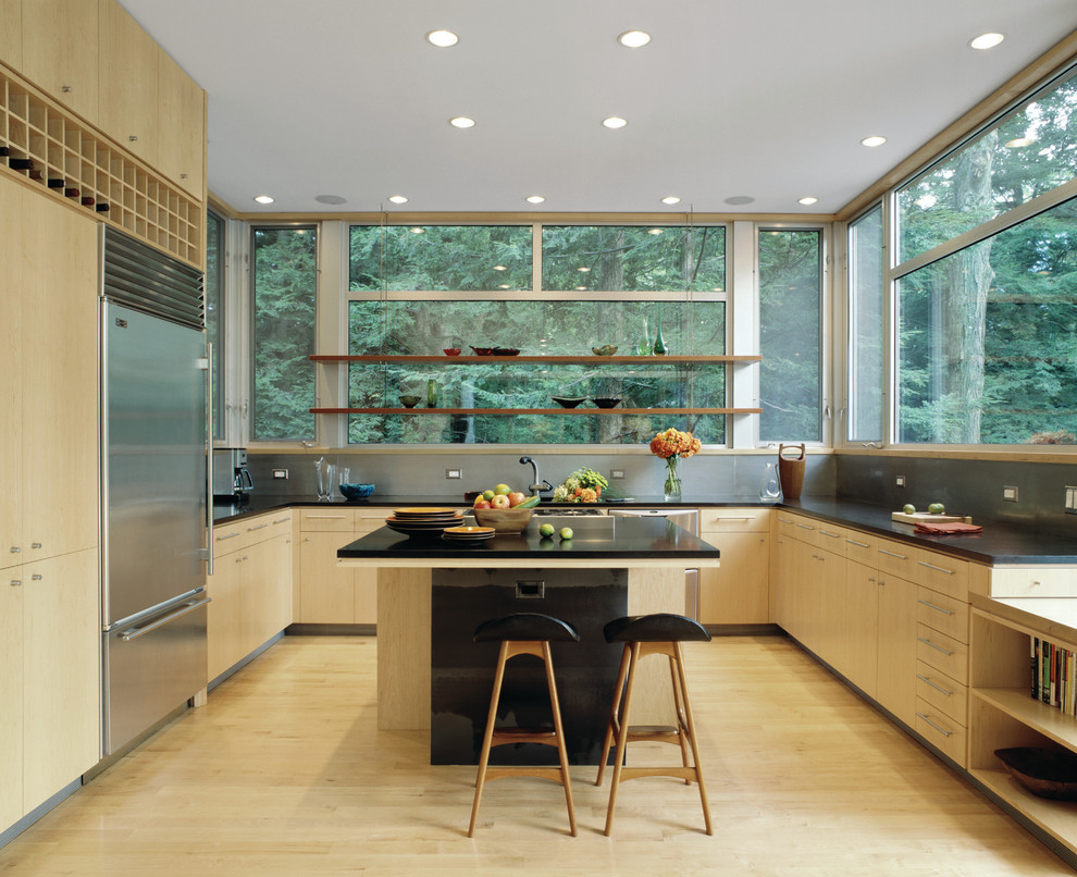 Inspiration for a modern kitchen remodel in New York with flat-panel cabinets, light wood cabinets and stainless steel appliances