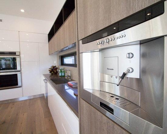 Modern kitchen cabinets - build in coffee machine