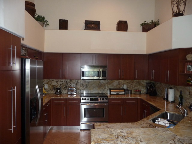 Modern kitchen cabinets shown in cherry wood for Modern kitchen cupboards