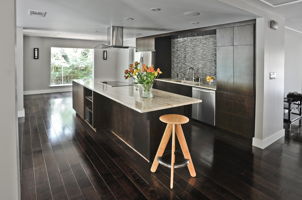 Minimalist galley kitchen photo in Austin with flat-panel cabinets, brown cabinets, gray backsplash and stainless steel appliances