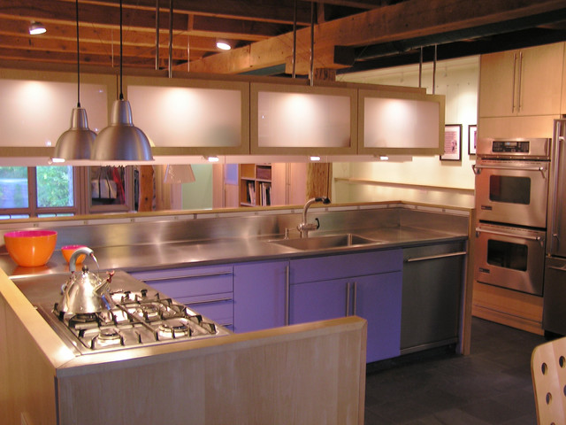 Modern kitchen inserted into antique carriage house for Carriage house kitchen cabinets