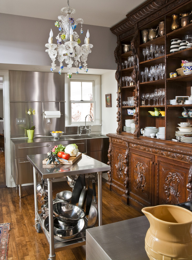 Kitchen - eclectic kitchen idea in Other with stainless steel countertops, an integrated sink, open cabinets, dark wood cabinets, metallic backsplash and metal backsplash