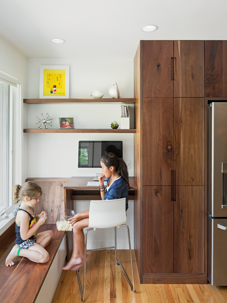Example of a trendy medium tone wood floor kitchen design in Philadelphia with flat-panel cabinets and dark wood cabinets