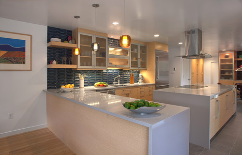 A modern kitchen with concrete-like countertops