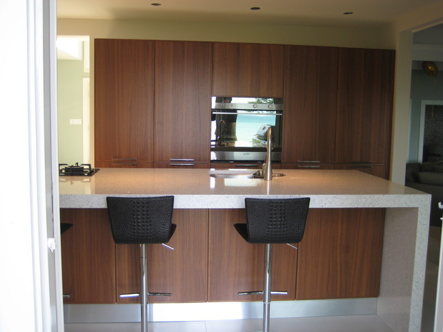 Modern Kitchen, white countertops, walnut cabinets