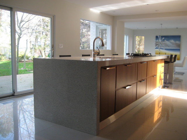 modern kitchen white countertops walnut cabinets