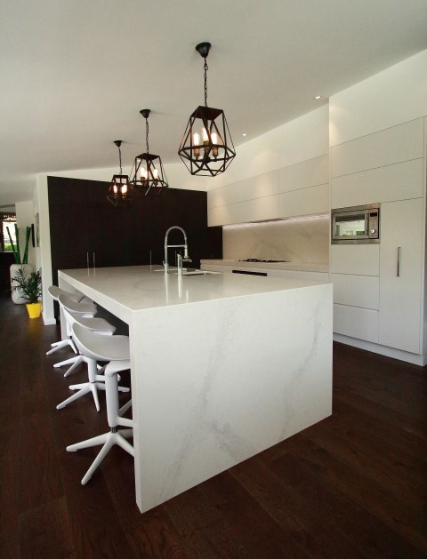 modern kitchen with large island bench in calacatta