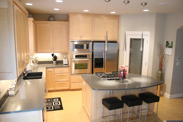 Modern Kitchen With Maple Cabinets And Quartz Counters