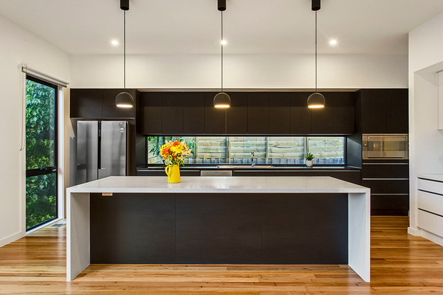 Modern Kitchen With Stone Island Bench Feature Lighting