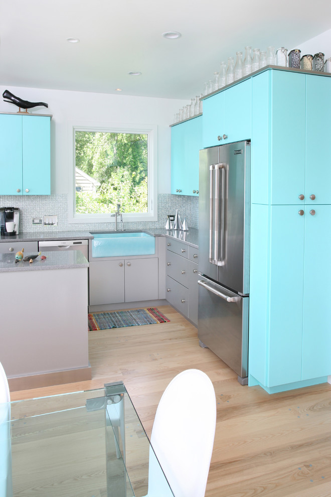 Example of a trendy kitchen design in Boston with stainless steel appliances and a farmhouse sink