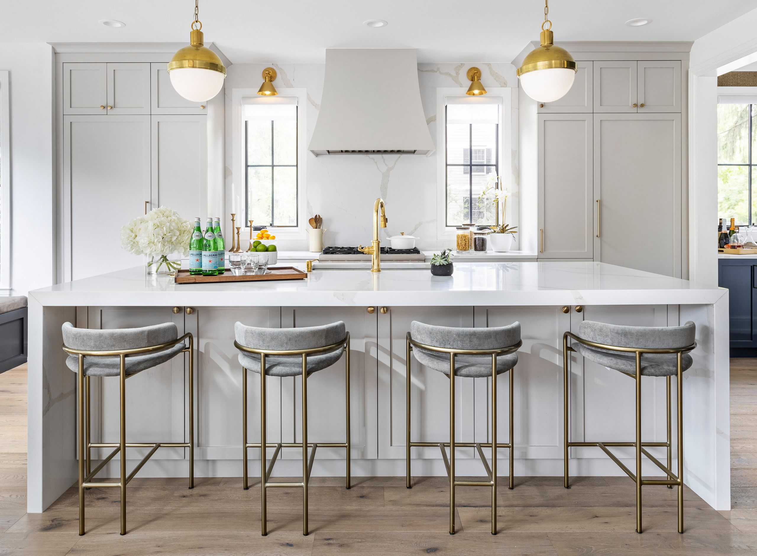 This stylish, family friendly kitchen is also an entertainer's dream! This young family desired a bright, spacious kitchen that would function just as well for the family of 4 everyday, as it would fo