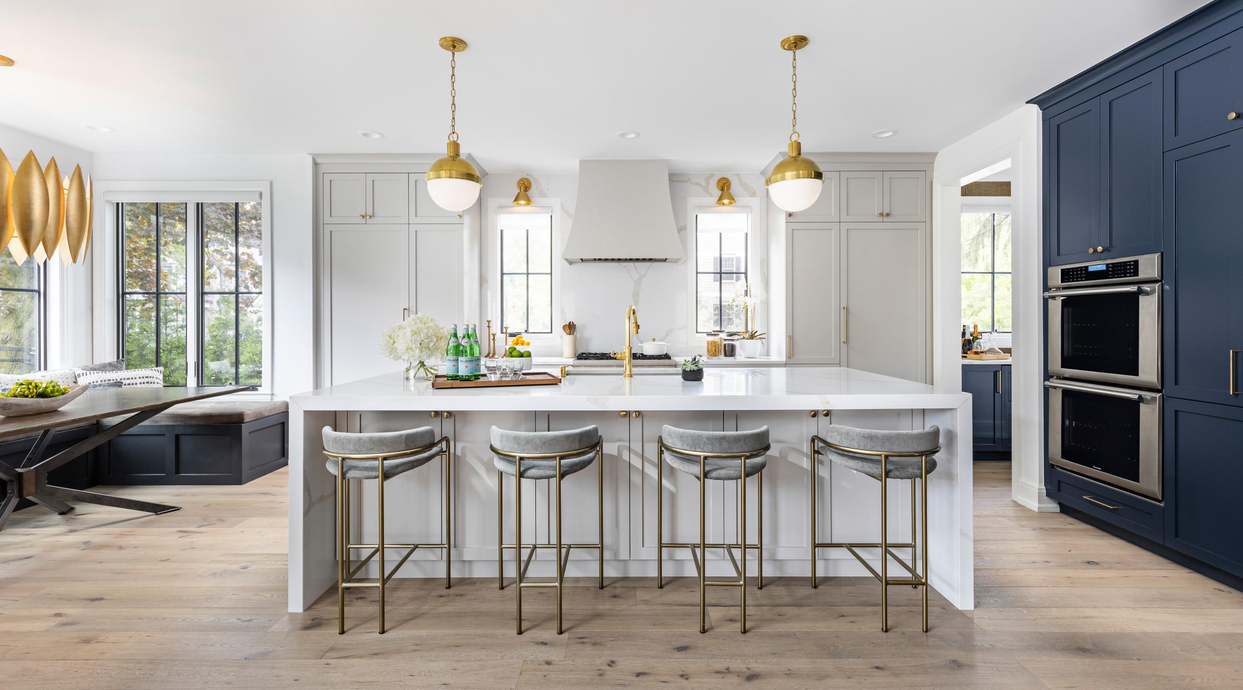 Large minimalist l-shaped light wood floor and brown floor open concept kitchen photo in Detroit with an undermount sink, shaker cabinets, blue cabinets, quartz countertops, white backsplash, quartz b