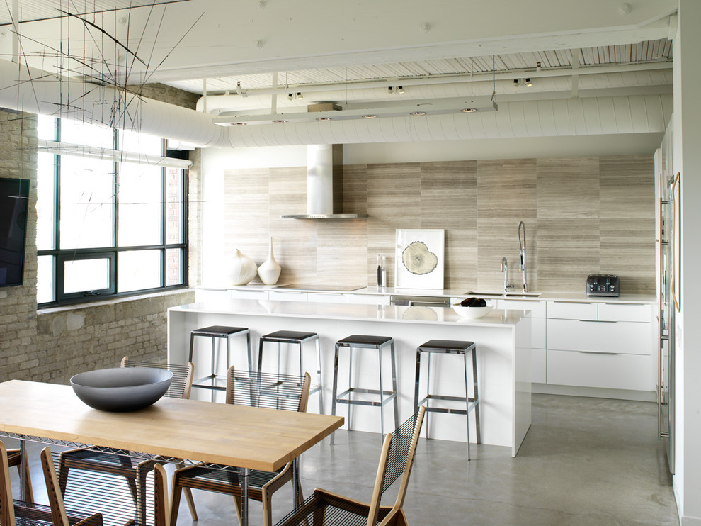 Eat-in kitchen - mid-sized industrial l-shaped concrete floor and gray floor eat-in kitchen idea in Toronto with quartz countertops, flat-panel cabinets, white cabinets, a double-bowl sink, beige backsplash, porcelain backsplash, stainless steel appliances and an island