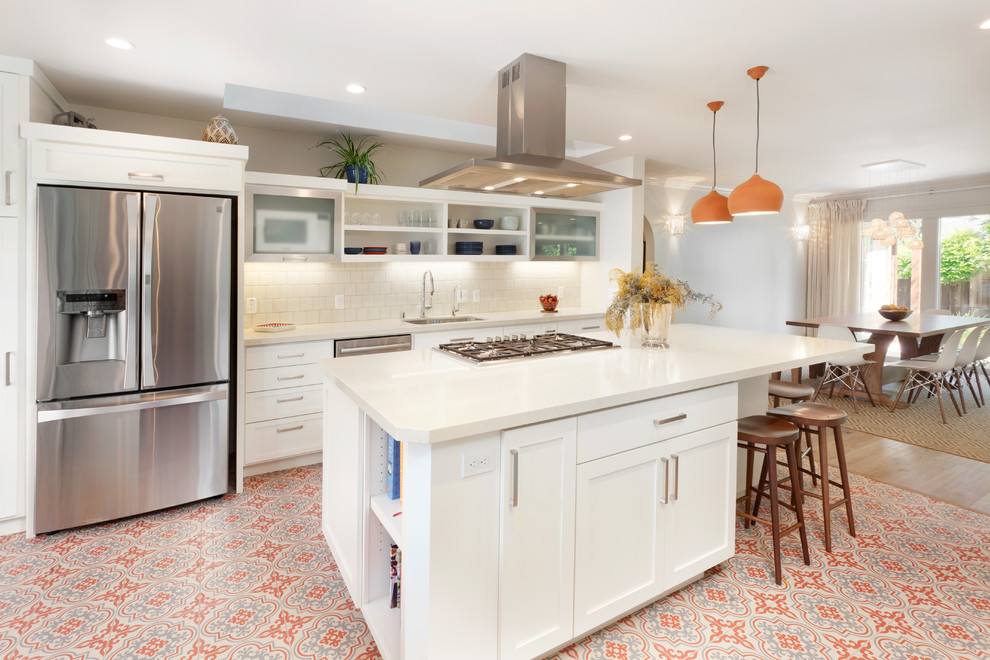 Tuscan galley ceramic tile and multicolored floor eat-in kitchen photo in San Francisco with shaker cabinets, white cabinets, solid surface countertops, white backsplash, ceramic backsplash, stainless steel appliances, an island, an undermount sink and white countertops