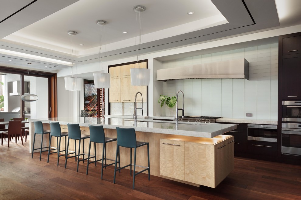 Inspiration for a contemporary dark wood floor and brown floor eat-in kitchen remodel in Miami with an undermount sink, flat-panel cabinets, white backsplash, glass tile backsplash, stainless steel appliances and an island