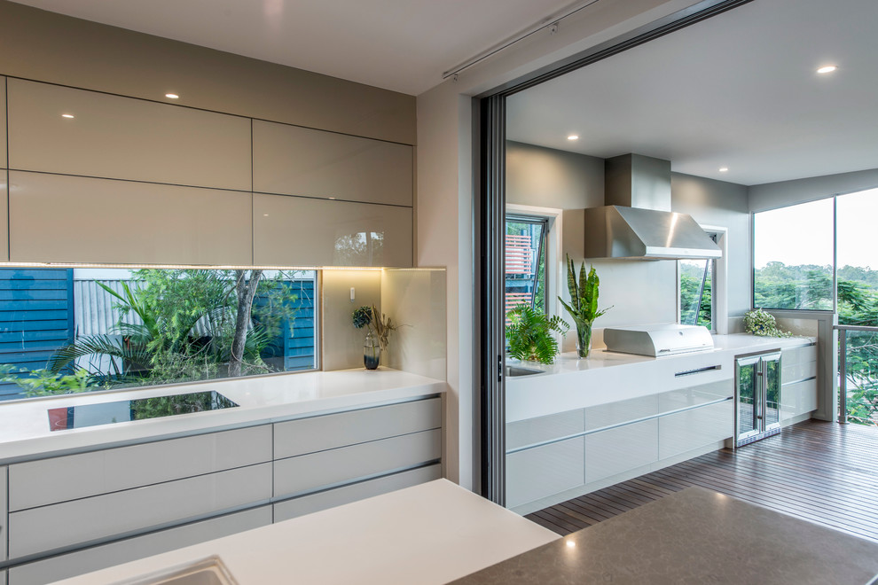 This is an example of a contemporary kitchen in Brisbane.