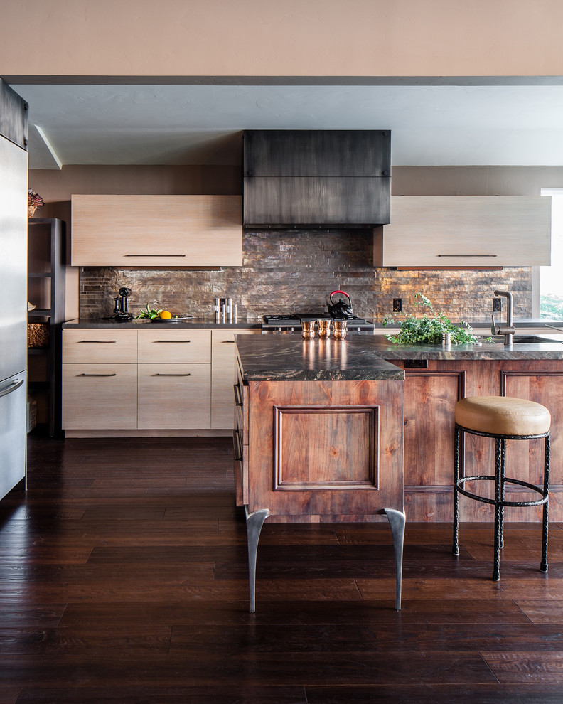 Inspiration for a contemporary kitchen remodel in San Francisco with flat-panel cabinets, light wood cabinets, metallic backsplash, metal backsplash and stainless steel appliances