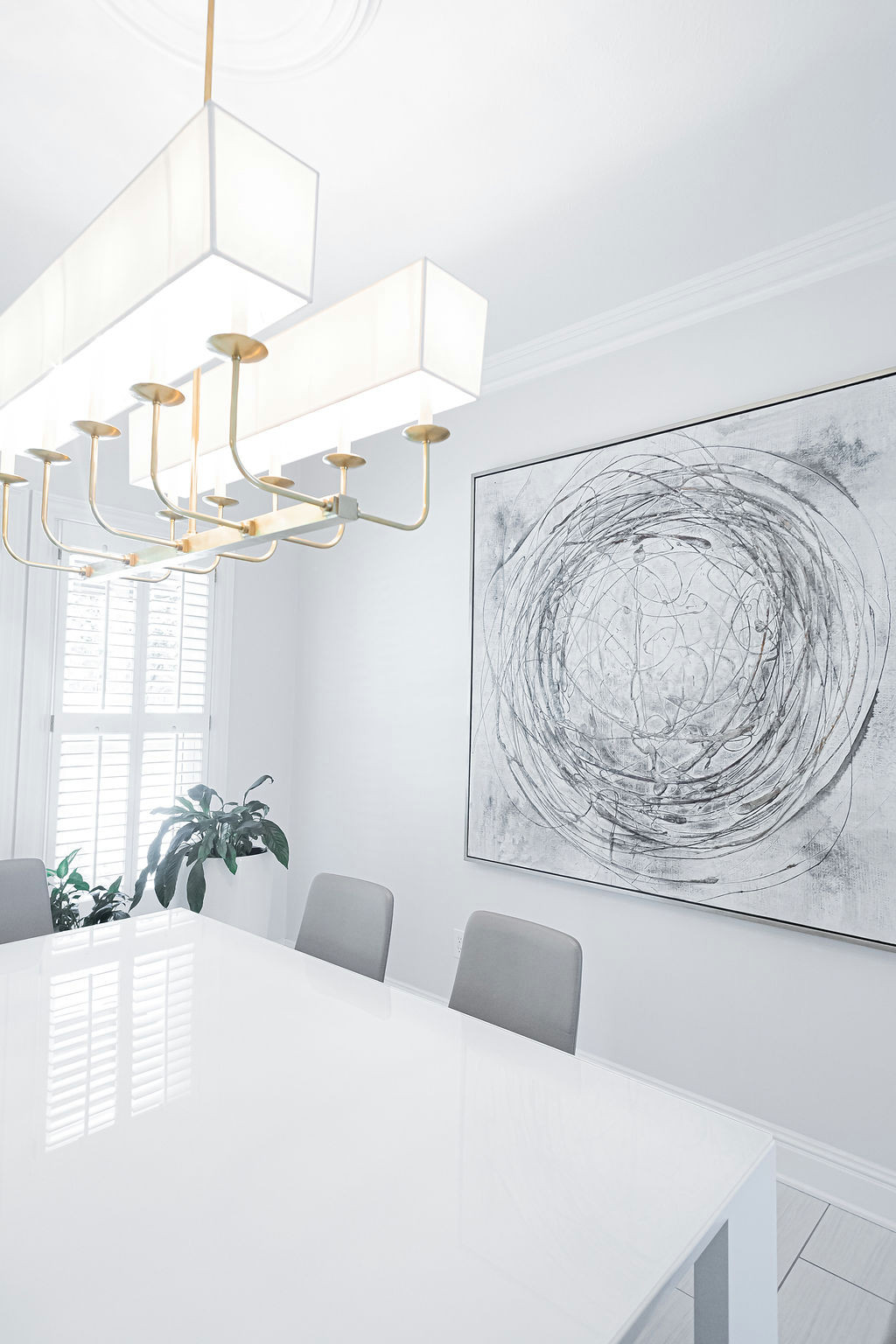 Modern table, chairs, and art