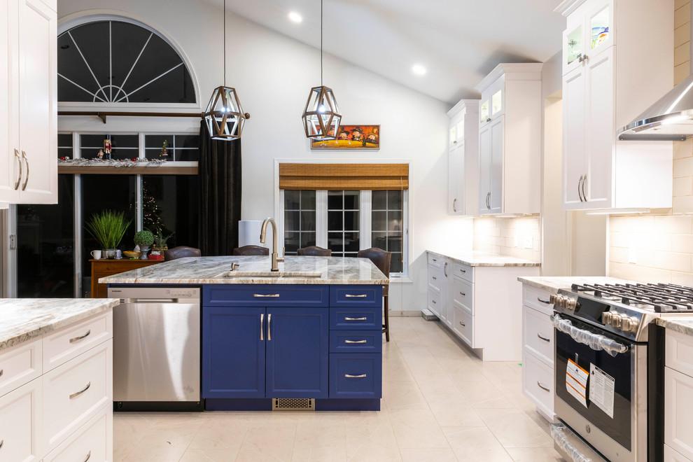 Large minimalist porcelain tile and beige floor kitchen photo in Ottawa with an undermount sink, shaker cabinets, granite countertops, white backsplash, porcelain backsplash, stainless steel appliances, an island, white countertops and blue cabinets