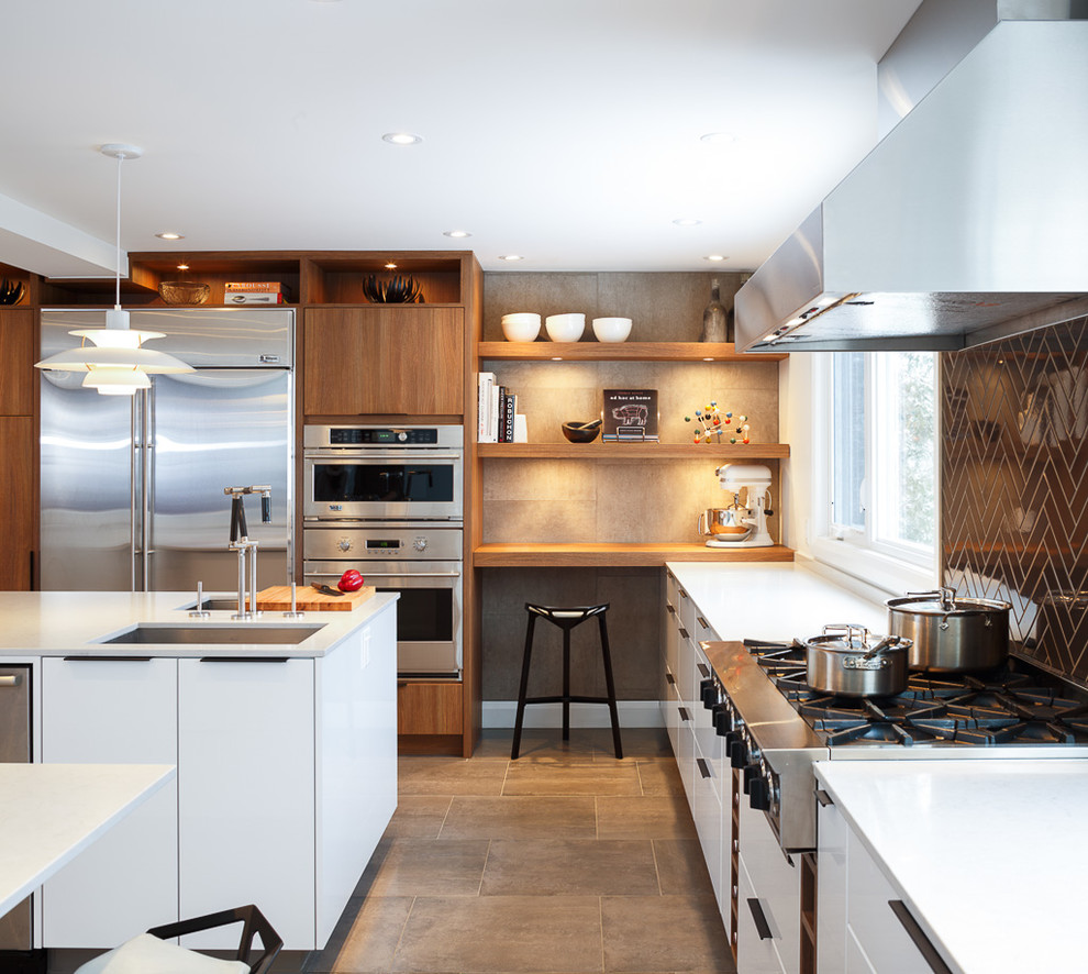 Open concept kitchen - contemporary gray floor open concept kitchen idea in Ottawa with black backsplash, an undermount sink, flat-panel cabinets, white cabinets, quartz countertops, subway tile backsplash, stainless steel appliances and an island