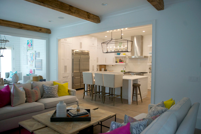 Mid-sized minimalist u-shaped light wood floor open concept kitchen photo in Atlanta with an undermount sink, shaker cabinets, white cabinets, marble countertops, white backsplash, subway tile backsplash, stainless steel appliances and an island