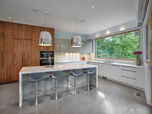 Large trendy l-shaped concrete floor and gray floor kitchen pantry photo in Edmonton with a double-bowl sink, flat-panel cabinets, marble countertops, blue backsplash, glass tile backsplash, paneled appliances, an island and dark wood cabinets