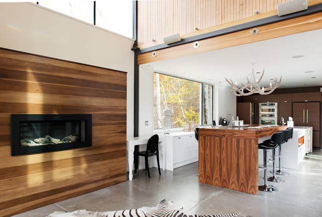 Inspiration for a contemporary kitchen remodel in Montreal with wood countertops