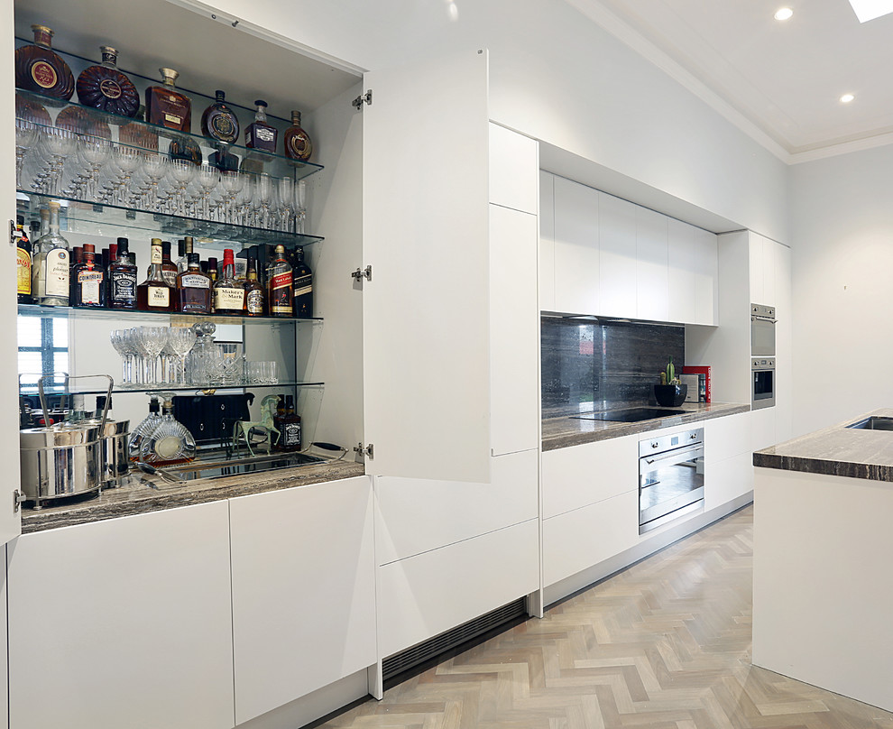 Example of a large trendy single-wall bamboo floor open concept kitchen design in Melbourne with a drop-in sink and an island