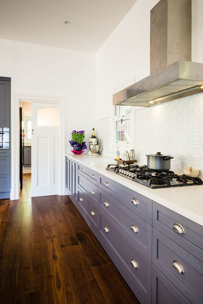Inspiration for a transitional kitchen remodel in Melbourne with recessed-panel cabinets, blue cabinets, granite countertops, an island and white backsplash