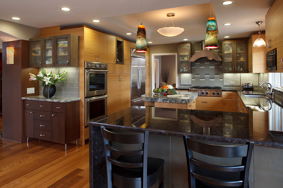 Example of a mid-sized trendy u-shaped medium tone wood floor open concept kitchen design in San Francisco with a single-bowl sink, flat-panel cabinets, light wood cabinets, marble countertops, gray backsplash, glass tile backsplash, stainless steel appliances and an island