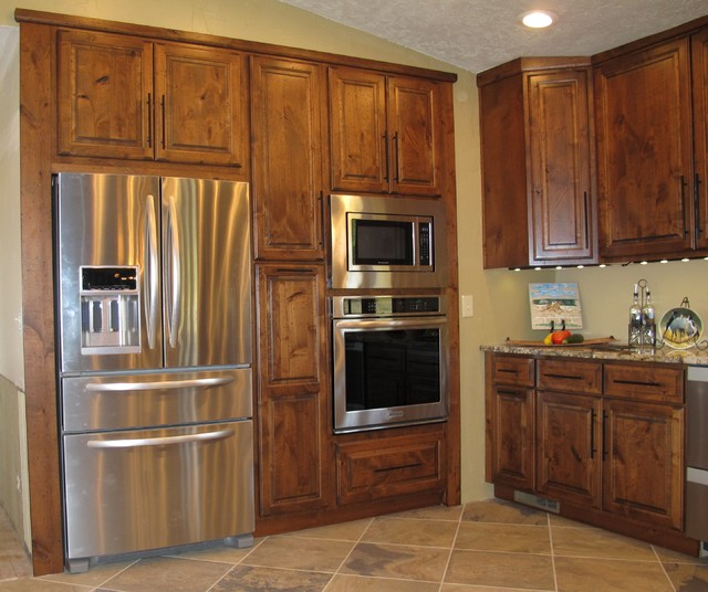 Custom built in raised panel refrigerator and oven cabinet for Built in oven kitchen cabinets