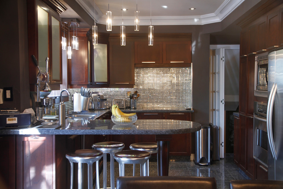 Trendy kitchen photo in Montreal with granite countertops and stainless steel appliances
