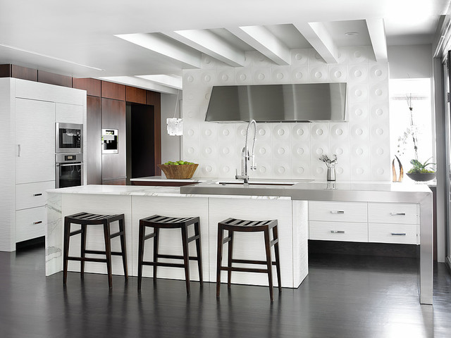 Inspiration for a mid-sized modern l-shaped dark wood floor open concept kitchen remodel in Atlanta with a farmhouse sink, flat-panel cabinets, white cabinets, marble countertops, white backsplash, ceramic backsplash, stainless steel appliances and an island