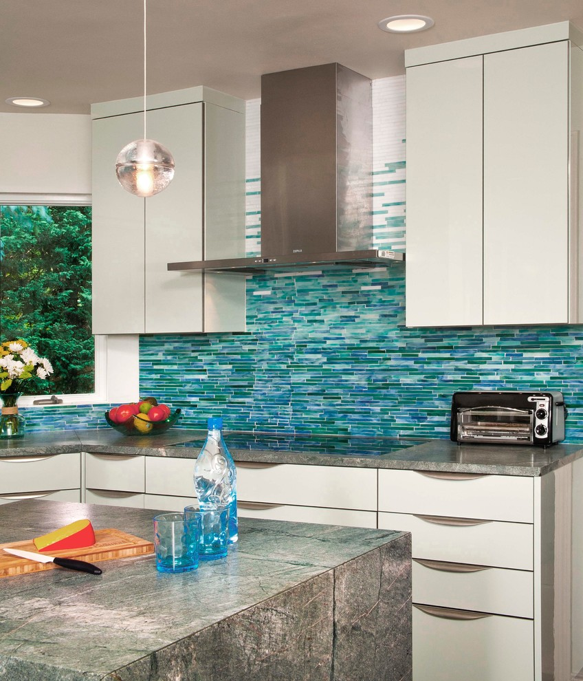 Large trendy dark wood floor kitchen photo in Seattle with green backsplash, matchstick tile backsplash, an undermount sink, flat-panel cabinets, green cabinets, granite countertops, stainless steel appliances and an island