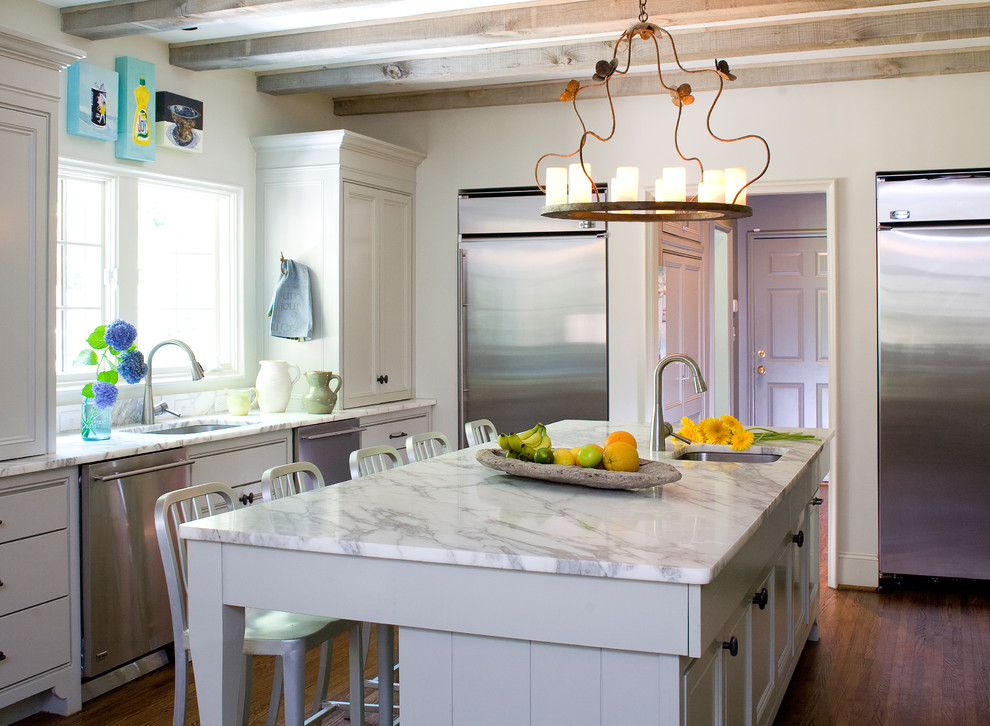 Inspiration for a rustic kitchen remodel in Birmingham with stainless steel appliances and marble countertops