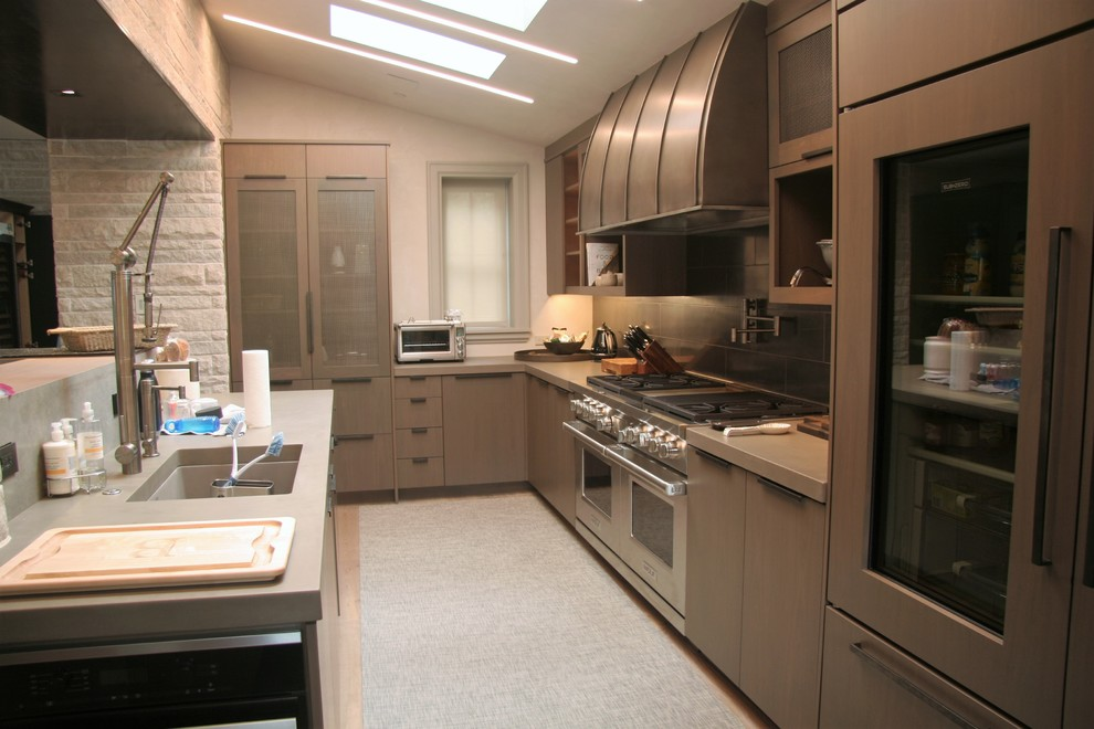 Inspiration for a mid-sized modern l-shaped light wood floor open concept kitchen remodel in Denver with an undermount sink, flat-panel cabinets, an island, brown cabinets, zinc countertops, gray backsplash, porcelain backsplash and stainless steel appliances