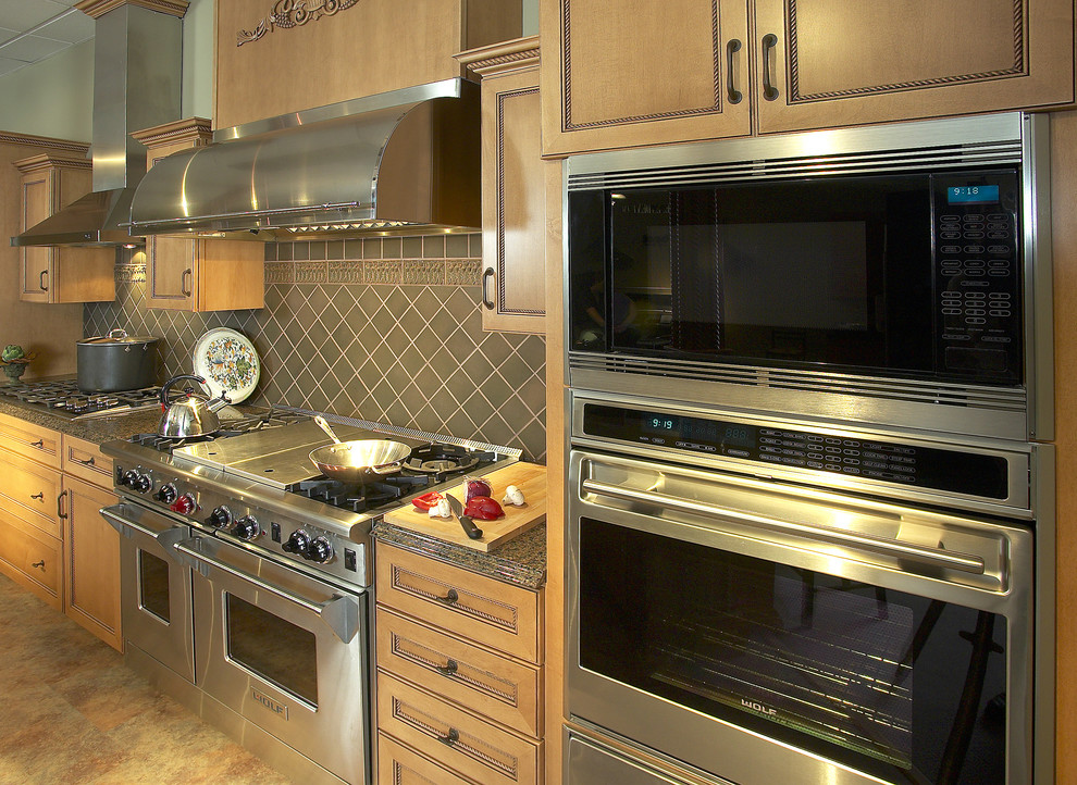 Inspiration for a mid-sized timeless single-wall ceramic tile enclosed kitchen remodel in Boston with stainless steel appliances, gray backsplash, recessed-panel cabinets, medium tone wood cabinets, granite countertops, ceramic backsplash and no island