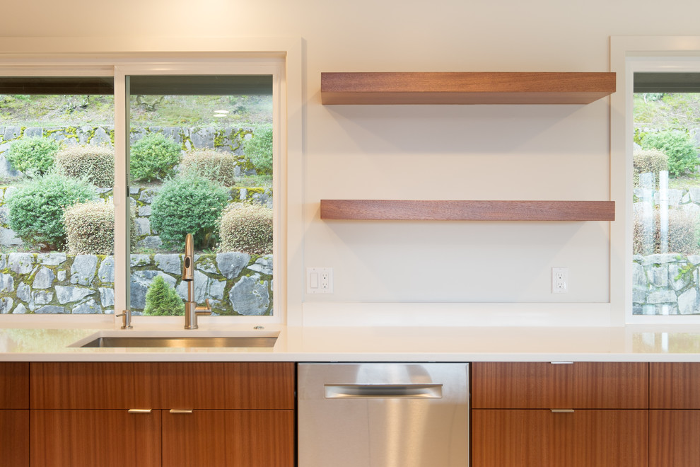 Example of a large minimalist l-shaped porcelain tile eat-in kitchen design in Portland with an undermount sink, flat-panel cabinets, medium tone wood cabinets, quartz countertops, stainless steel appliances and an island