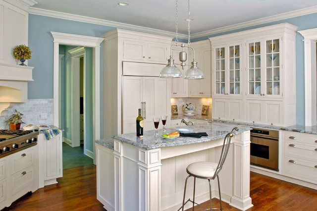Multi Level White Cabinet Breakfast Island With Ice Blue Countertops Traditional Kitchen