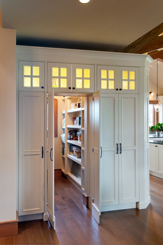 Inspiration for a timeless medium tone wood floor kitchen pantry remodel in Vancouver with recessed-panel cabinets and white cabinets