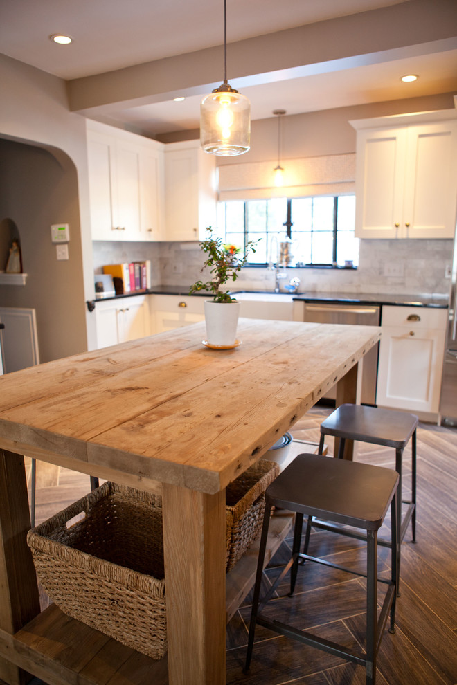 Example of a classic kitchen design in Boston with shaker cabinets