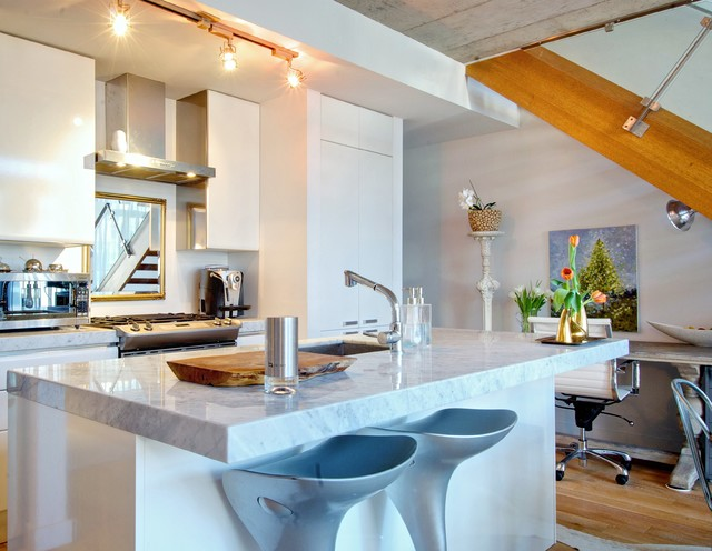 Example Of A Trendy Kitchen Design In Toronto With Flat Panel Cabinets And Granite Countertops