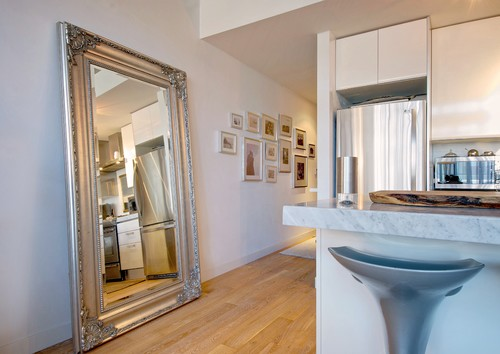 large leaning mirror an oversized framed mirror can be included in a kitchens design place a big mirror near the entryway to reflect the beautiful
