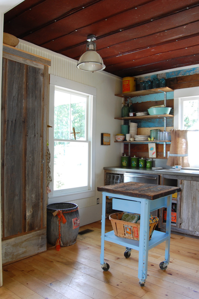 Example of a cottage kitchen design in New York with open cabinets and distressed cabinets