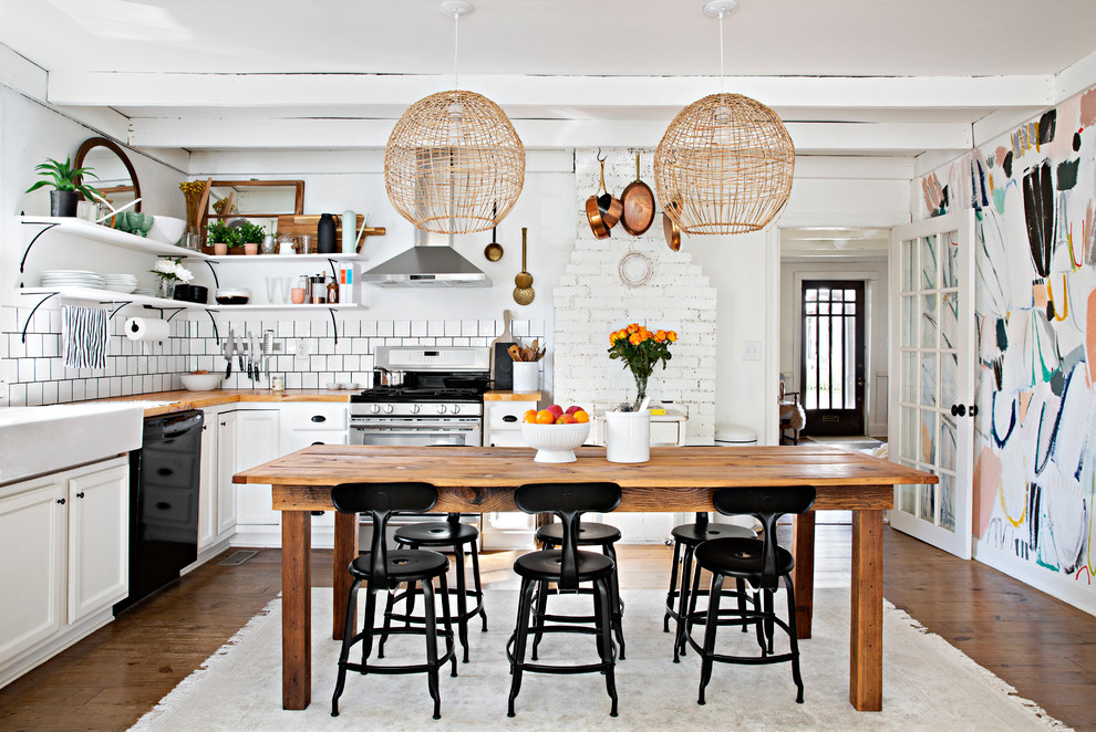 Eat-in kitchen - shabby-chic style l-shaped dark wood floor eat-in kitchen idea in Nashville with a farmhouse sink, recessed-panel cabinets, white cabinets, wood countertops, white backsplash and stainless steel appliances