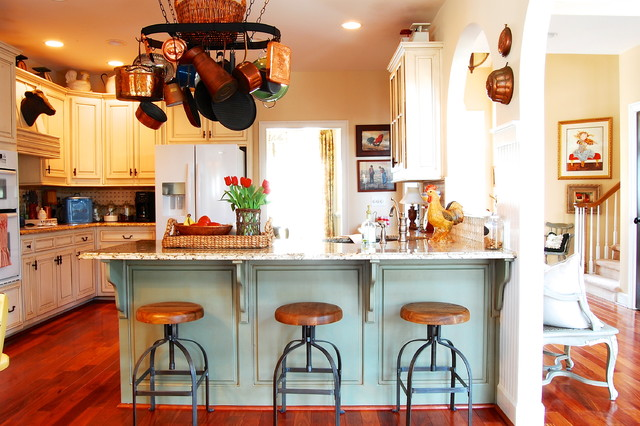 Country kitchen photo in New York with an undermount sink raised-panel cabinets & French Country Counter Stools | Houzz islam-shia.org