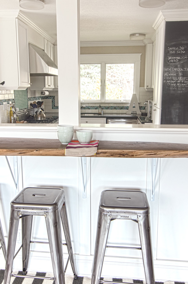 Trendy kitchen photo in San Francisco with wood countertops