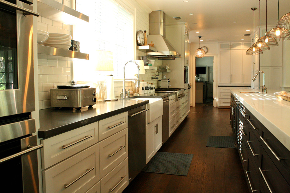 Inspiration for a transitional kitchen remodel in Tampa with a farmhouse sink, white backsplash, subway tile backsplash and stainless steel appliances