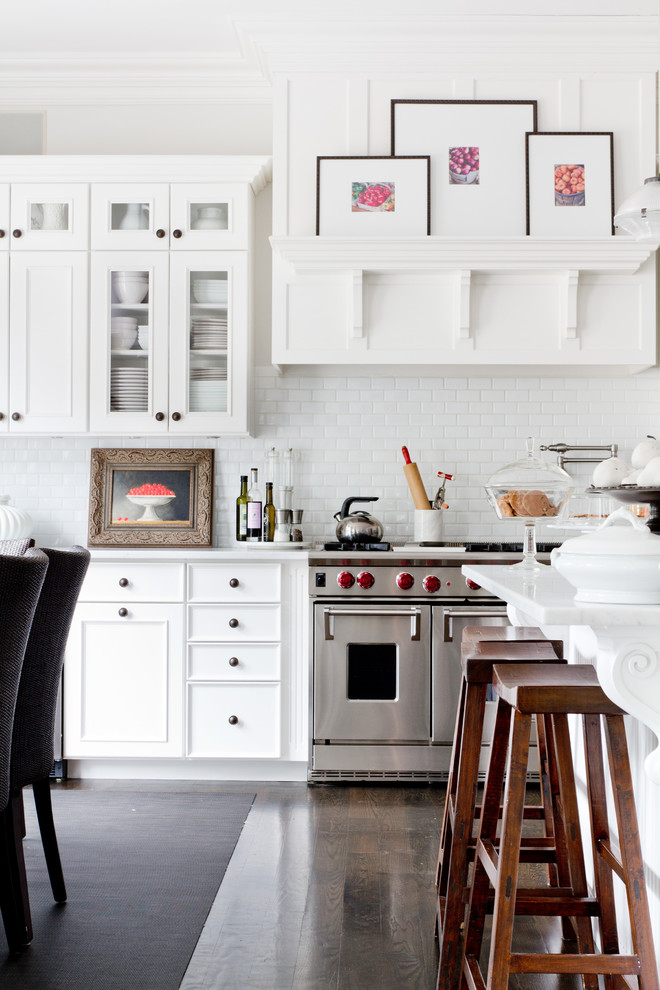 Inspiration for a timeless kitchen remodel in New York with recessed-panel cabinets, white cabinets, white backsplash, subway tile backsplash and stainless steel appliances